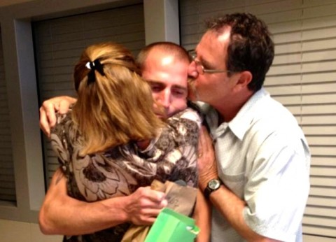 Uriah Courtney and parents embrace as he leaves prison
